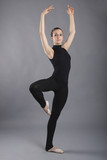 Portrait of young dancer isolated on grey background. Ballerina
