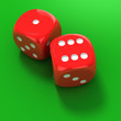 Two red dice on the green