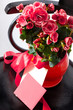 Holiday bouquet of red flowers on black retro chear