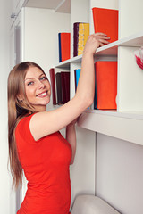 woman getting book and smiling