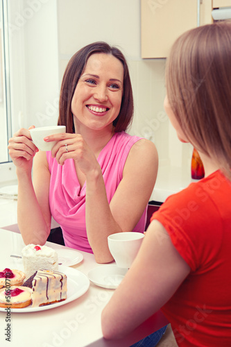 girls sitting on the kitchen and talking