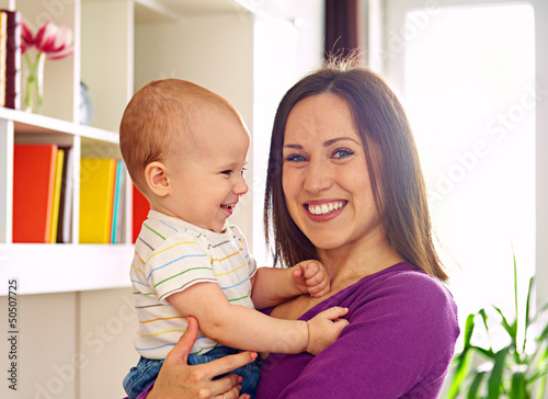 mother and cute son at livingroom
