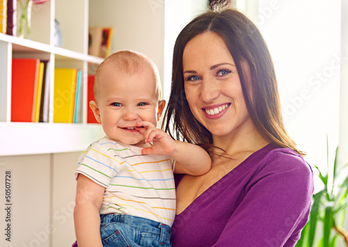 mother holding her cute son