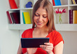 young woman using the tablet pc