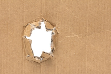 white hole in a cardboard background