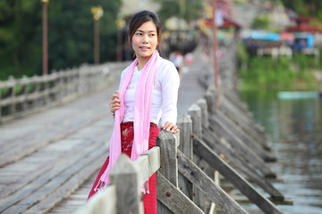 lady and the architecture of wooden bridge