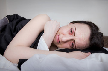 woman crying in bed