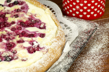 The cake baked with fruit and cottage cheese