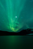 Fototapety Northern lights above lagoon in Iceland