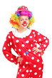 Smiling female clown in a red costume posing