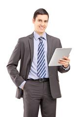 Smiling businessman holding a tablet