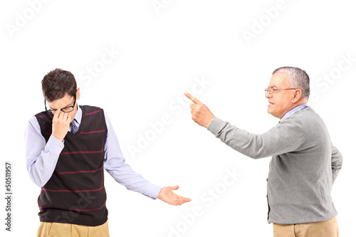 Angry mature man having an argument with a younger upset man