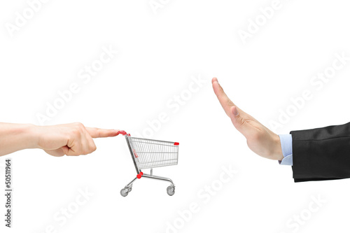 Finger pushing an empty shopping cart and male hand gesturing st