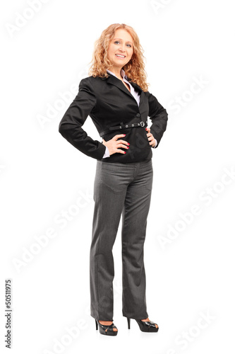 Full length portrait of a smiling professional woman posing