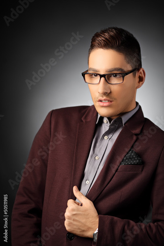 Handsome and fashionable young man posing