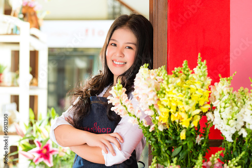 Asian Saleswoman in a flower shop