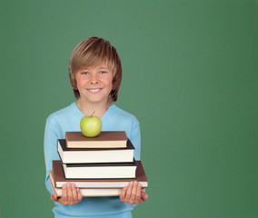 Preteen boy with a many books