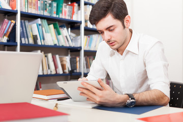 Student using his tablet