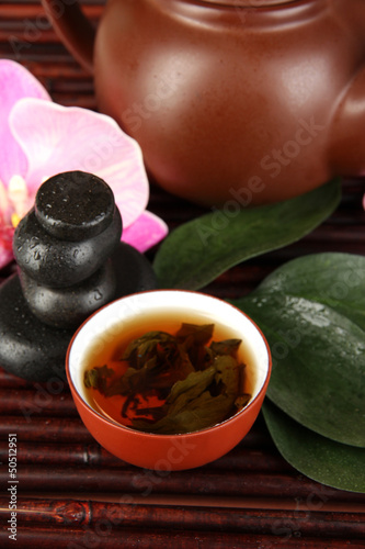 Chinese tea ceremony on bamboo table close-up
