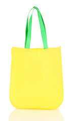 Yellow bag with green handles isolated on whit