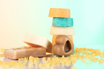 Variety of handmade soap on light background