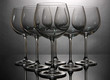 Empty wine glasses arranged on grey background