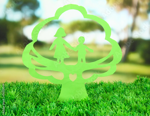 Green cut out paper tree with people inside,