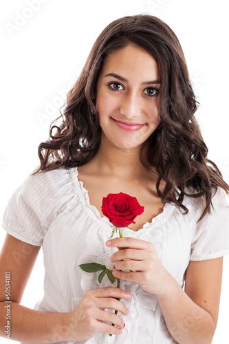 Cute tween girl holding a red rose portrait