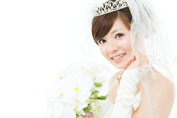Beautiful asian woman dressed as a bride on white background