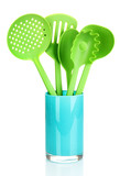 Green plastic kitchen utensil isolated on white