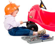 One small little girl repairing toy car.