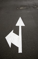 Directional arrow on asphalt