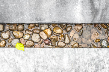 Path of pebble in water framed with stone.