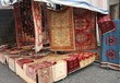 street big stall with resale of ancient Persian carpets