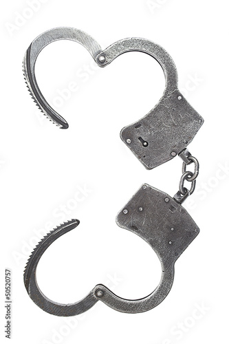 Metal handcuffs for hands on a white background