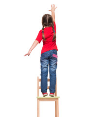 little girl wearing red t-shirt and reaching out something up hi