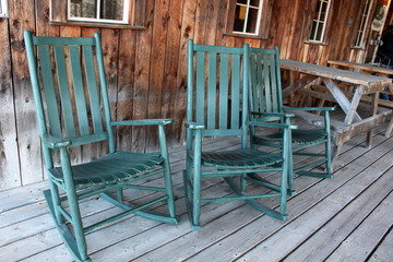 Three green rocking chairs