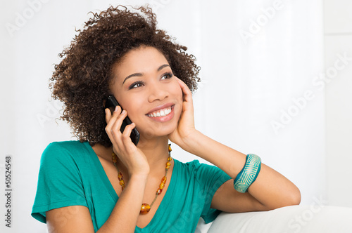 Happy Woman Talking On Cellphone