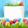 Easter greeting card with colorful eggs on wooden background