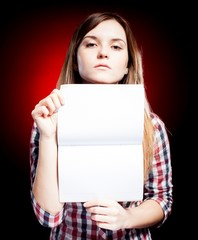 Proud young girl holding exercise book