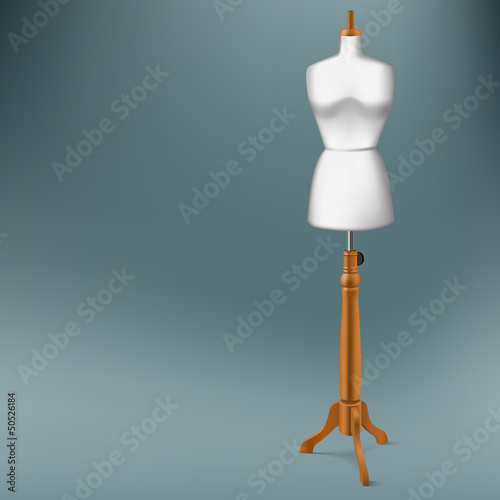 white tailor dummy with wood stand