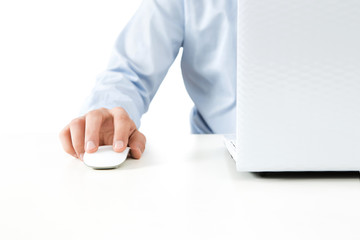 Close up of young man working on a laptop isolated on white