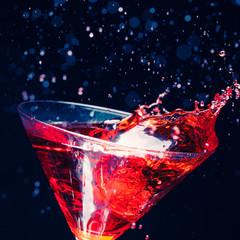 red splashing cocktail on black