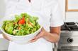 Female Chef Presenting Salad