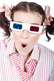 Amazed woman watching 3D movie in glasses