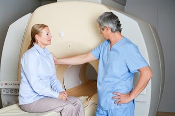 Technician Comforting Female Patient