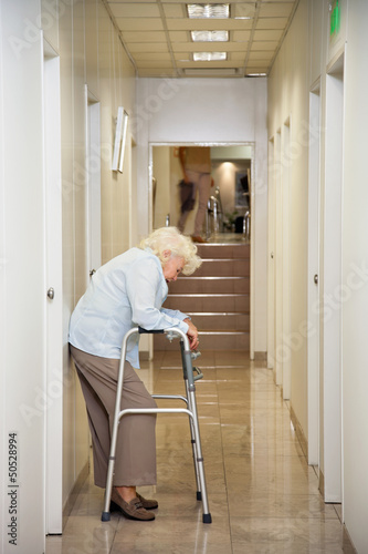 Elderly Woman Standing In Passageway