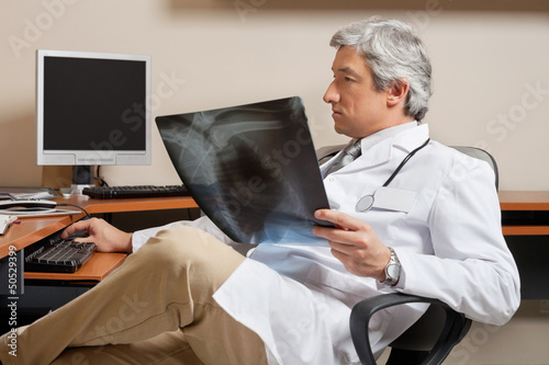 Radiologist Holding Shoulder X-ray