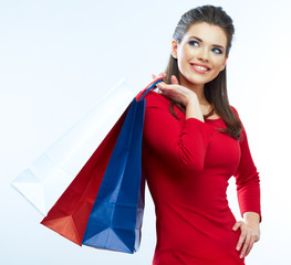 Woman hold shopping bags isolated on white background.