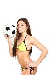 Happy young woman holding a soccer ball on a white background